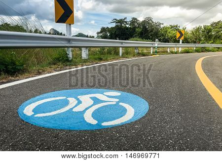 Bike lanes. Bike lane in suburb area with bike lane icon indicated. Bike lane sign on asphalt road.