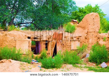 Historic collapsing adobe dwelling which is centuries years old taken in Taos, NM