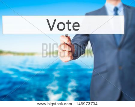 Vote - Businessman Hand Holding Sign