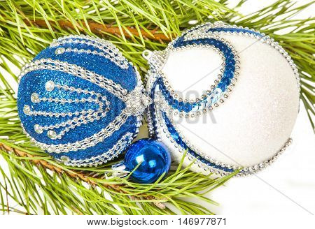 Christmas tree and blue ball with white glitter on white