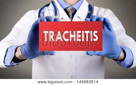 Doctor's hands in blue gloves shows the word tracheitis. Medical concept.