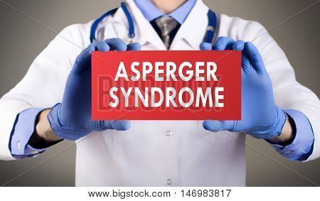 Doctor's hands in blue gloves shows the word asperger syndrome. Medical concept.