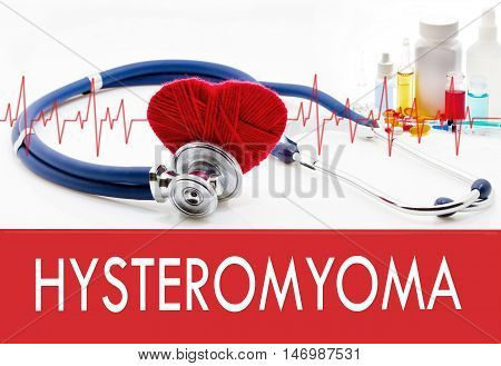 Medical concept hysteromyoma. Stethoscope and red heart on a white background