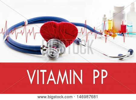 Medical concept vitamin pp. Stethoscope and red heart on a white background