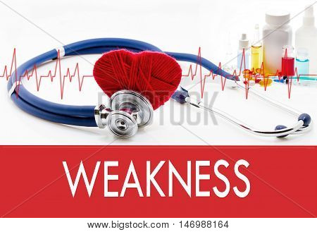 Medical concept weakness. Stethoscope and red heart on a white background