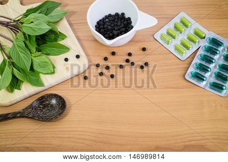 Alternative Medicine, Blisters Of Capsules Herbal Pills, Tablets On Wood Background