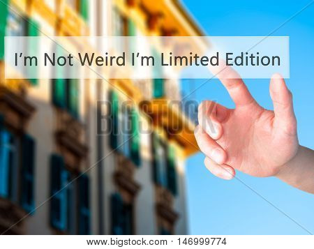 I'm Not Weird Im Limited Edition - Hand Pressing A Button On Blurred Background Concept On Visual Sc