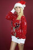 Beautiful girl wearing a kitsch Christmas sweater poster