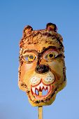 Spring feast Mardi Gras lion mask on blue sky background poster