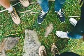 Hiking shoes on hiker outdoors walking crossing river creek. Woman and men on hike trekking in nature. Close up of hiking boots. poster