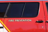Fire department vehicle used for fire prevention education. poster