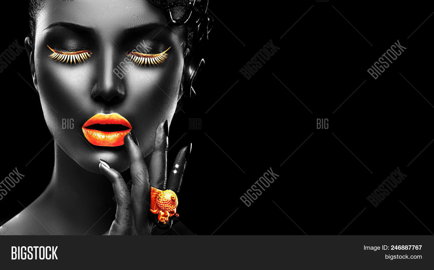 148e235a827 High Fashion Model with black skin, gold lips, eyelashes and jewellery -  golden ring