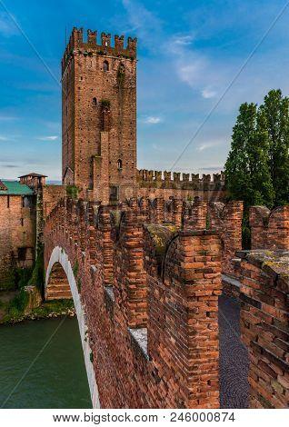 poster of The Castel Vecchio Bridge (or Scaliger Bridge), a medieval fortified bridge in Verona, that spans river Adige, in Veneto, Italy.