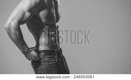 Workout. Dieting And Fitness. Coach Sportsman With Bare Chest. Athletic Bodybuilder Man On Grey Back