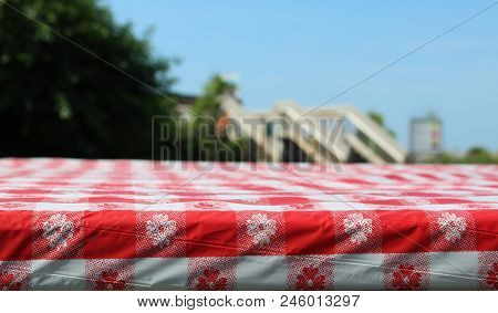 Red And White Table Cloth On Picnic Table