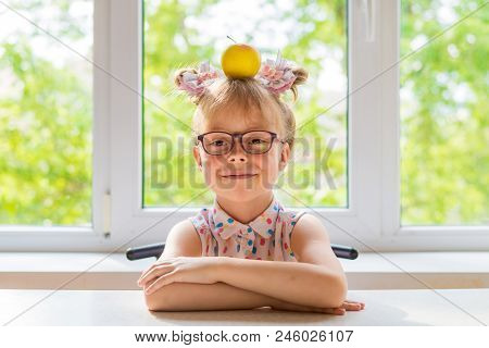 Little Schoolgirl With An Apple On The Table, Free Space.