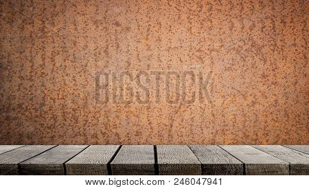 Empty Wooden Shelf On Rustic Metal Wall For Product Display