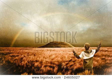 Landscape with rainbow and boy - spiritual scene, retro look image