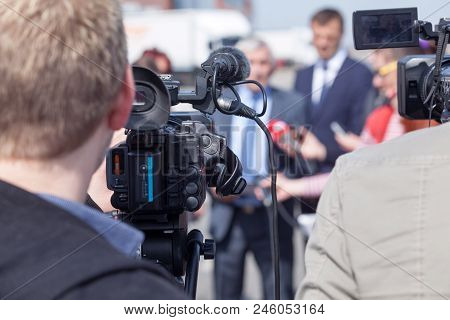 Covering A Public Event With A Video Camera. Broadcast Journalism.