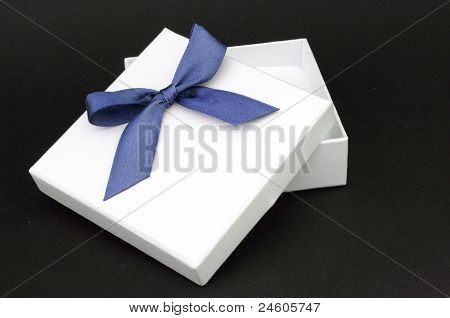 White Gift With Blue Ribbon