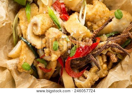 Fresh Greek Squids Calamari With Red Hot Chili Pepper On Rustic Wooden Background