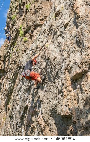 Yuzhnoukrainsk, Ukraine - June 19, 2018: Rock Climbing. A Young Climber Climbs A Vertical Granite Ro