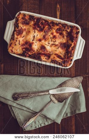 Italian Lasagna Bolognese And Mozzarella Cheese On Dark Wooden Background