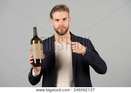 You Should Try This. Man Holds Bottle Alcohol Drink. Social And Cultural Aspects Of Drinking. Busine