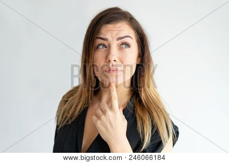 Pensive Caucasian Lady Planning, Thinking Long Haired Young Woman Leaning Chin On Index Finger And L