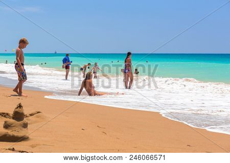Side, Turkey - June 6, 2018: People on the beach on Turkish Riviera near Side. Turkish Riviera is a popular tourist destination on the southwest Turkey area.