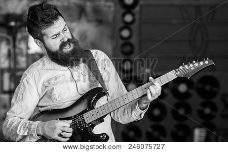 Rock Music Concept. Talented Musician, Soloist, Singer Play Guitar In Music Club On Background. Man