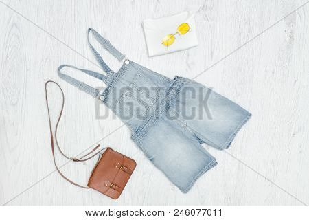Blue Denim Romper, Handbag And Sunglasses. Fashionable Concept