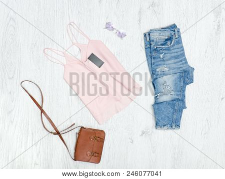 Pink Tank Top With Tag, Ripped Jeans, Handbag And Sunglasses. Fashionable Concept
