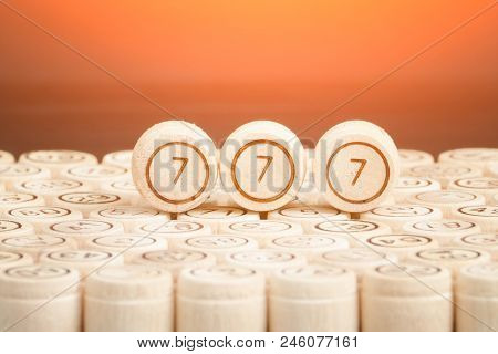 Lucky Number 777 On The Wooden Keg Lotto. Black Background. Close Up