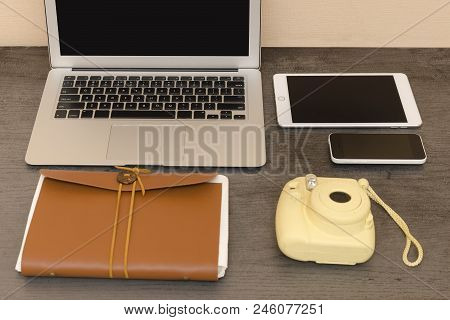 Laptop Keyboard, Yellow Camera, Notebook, Tablet And Smartphone. Workplace