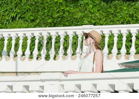 Girl In A Hat And Sunglasses Walking On Park. Sunny Day, Park