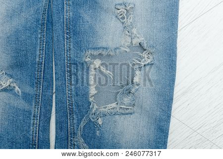 Part Of Blue Ripped Jeans. Details Close-up