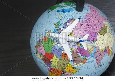 Kharkov, Ukraine- 13 April 2018: Airplane On The Globe. Travel Concept. Close Up