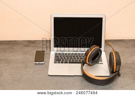 Laptop, Headphones And Smart Phone. Work Place