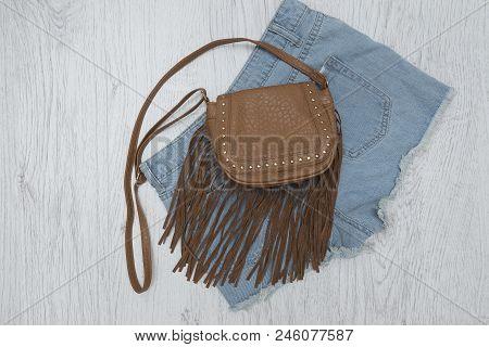 Brown Handbag On A Colour Denim Shorts. Fashionable Concept.