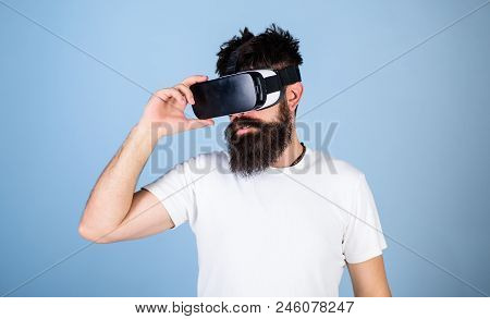 Man With Beard In Vr Glasses, Light Blue Background. Vr Gadget Concept. Guy With Head Mounted Displa