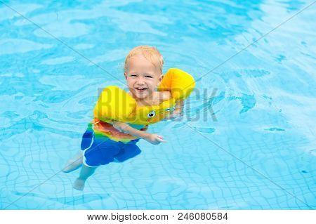 Baby In Swimming Pool. Kids Swim.