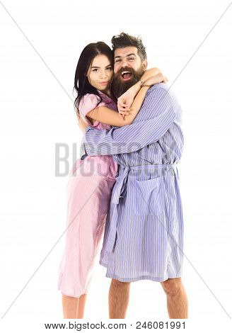 Couple, Family On Smiling Faces In Clothes For Sleep Looks Happy In Morning. Couple In Love Hugging
