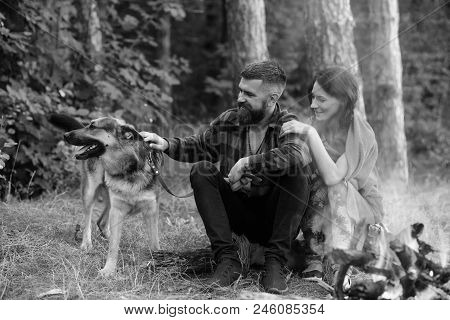 Woman And Man On Vacation, Enjoy Nature. Couple In Love, Young Happy Family Spend Leisure With Dog.