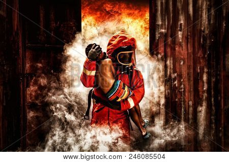 Firefighter Rescue., Fireman Walking Out From Burning Building And Hold Save A Child In His Arms Fro
