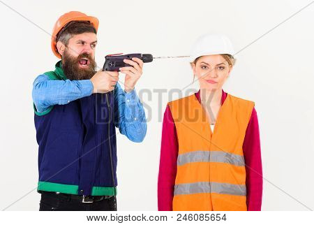 Annoying Repair Concept. Man With Drill Drills Head Of Woman, White Background. Husband Annoyed Wife