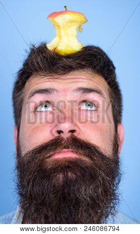 Man Handsome Hipster Long Beard Almost Eaten Apple Stump On Head As Target. Live Target Concept. Hip