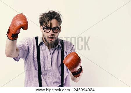 Weak Guy Makes Hits And Punches. Man With Bristle And Dull Face Wears Boxing Gloves. Nerd With Leath