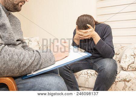 Male Psychologist Consulting Sad Depressive Man At Psychological Therapy Session, Psychologist Consu
