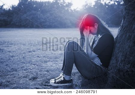 Woman Sit On The Grass And Feel Headache